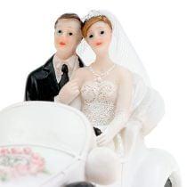 Bruidspaar bruid en bruidegom in een cabriolet 15 cm