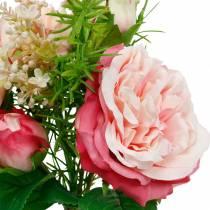 Boeket van kunstrozen in een bos van roze zijden bloemen boeket