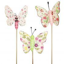 Vlinder op houten stok 5,5cm - 7cm 18st